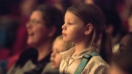 A young girl in the audience for The Nutcracker show