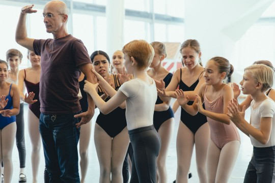 André Laprise and the children of The Nutcracker in rehearsal