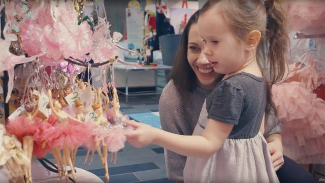 Anya and her daughter Katja admire ballerina-shaped Christmas ornaments at The Nutcracker Market