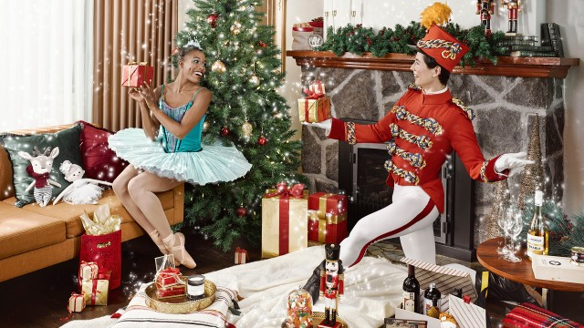 Our dancers Kiara and Hamilton surrounded by gifts from The Nutcracker Market