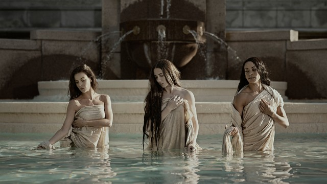 Three dancers in robes in a holy fountain represent the show Stabat MATER